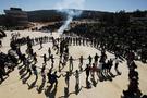 Türk bayrağıyla Nevruz ateşinden atladılar