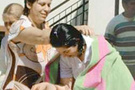 Papaz BDP'li yöneticiyi vaftiz etti