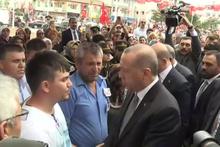 Erdoğan'dan şehit eşine ve ailesine taziye ziyareti