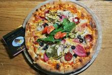 Bu pizza yenmez Firavun ve Roma krallarından esinlendi