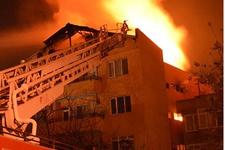 Oğlunu yangından kurtarmak için balkondan aşağı attı!