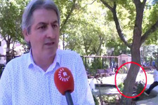 Röportaj sırasında parktaki gölete düşen çocuğu kameraman kurtardı