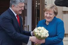 Merkel çiçeğe doyamadı Önce Putin şimdi ise