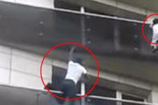 Kahraman genç balkondan sarkan çocuğu böyle kurtardı!