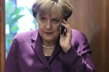 Merkel'den Davutoğlu'na kritik çağrı