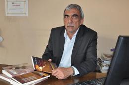 Bahçeli'den şair ve yazar Büyükerol'a destek