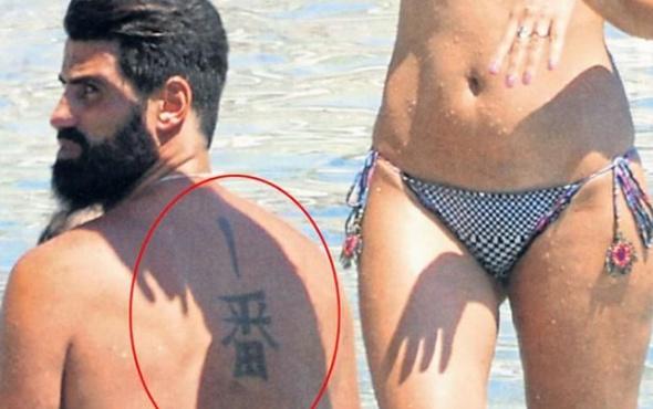 Volkan Demirel'in sırtındaki dövmede ne yazıyor?
