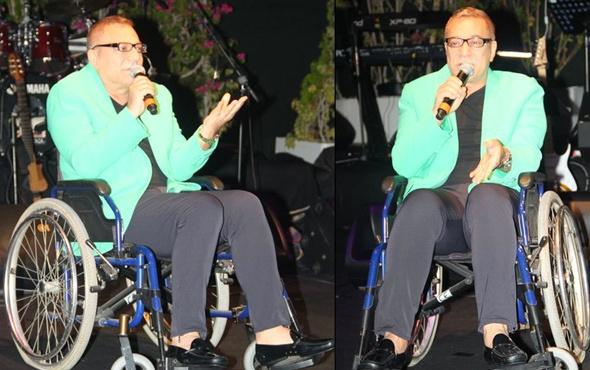 Mehmet Ali Erbil sahneye tekerlekli sandalyeyle çıktı
