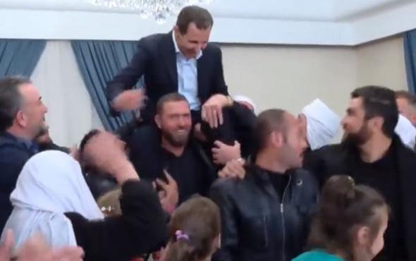 Beşar Esad'ı omuzlarına alıp kafasını avizeye vurdular
