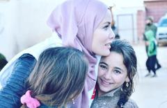 Tesettüre girmişti Gamze Özçelik İdlib'te çocukların yüzünü güldürdü