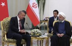 Üçlü zirve öncesi Erdoğan Ruhani ile görüştü