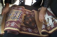 Kırşehir'deki operasyonda halının içinden paha biçilemez bir kitap çıktı