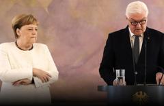 Kameralar önünde zangır zangır titreyen Angela Merkel'den açıklama!