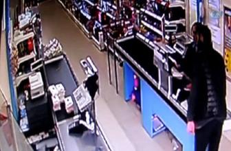 Silahlı soyguncu kameralara yakalandı