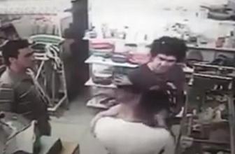 Tartıştığı adamın kucağındaki çocuğa yumruk attı