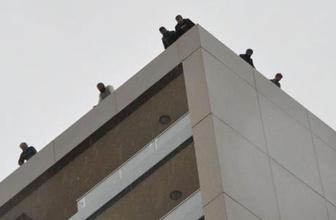 3 aydır paralarını alamayan inşaat işçileri çatıya ve vincin tepesine çıktı