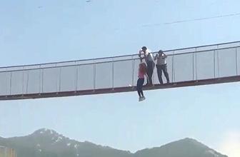 Tam o an: Köprüden atladı polis havada yakaladı!