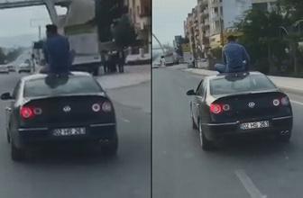 Batman'da otomobilin üstüne oturarak yolculuk yaptı