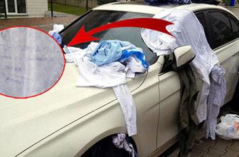 Eve gelmeyen eşinin kıyafetlerini otomobile bağladı