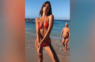 Plajda seksi pozlar veren kadının kadrajına giren amca sosyal medya olay oldu