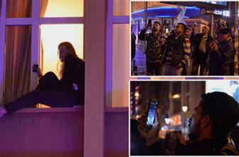 Adana'da pencereye çıkan kadını görenler cep telefonuna sarıldı