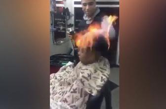 Ateşle saç tıraşı yaparken az kalsın müşterisini yakıyordu