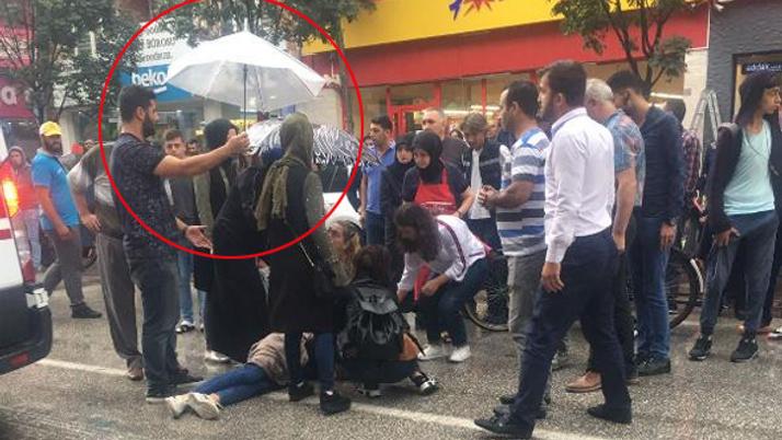 Kaza geçiren genç kıza şemsiyeli koruma