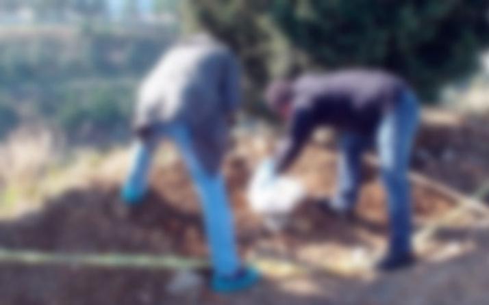 Mezarlıkta bulundu toprağa gömülü bezi çıkartınca...