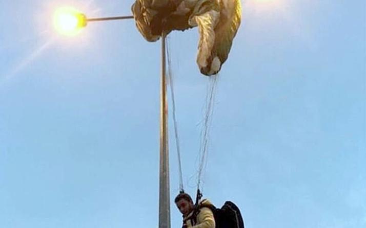 Paraşütçü elektrik direğinde asılı kaldı ilginç anlar...