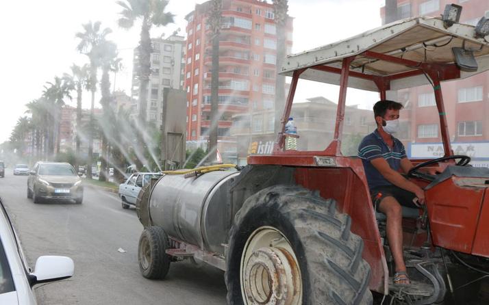 Kozan'da köylüler traktörlerle ilçeyi dezenfekte etti