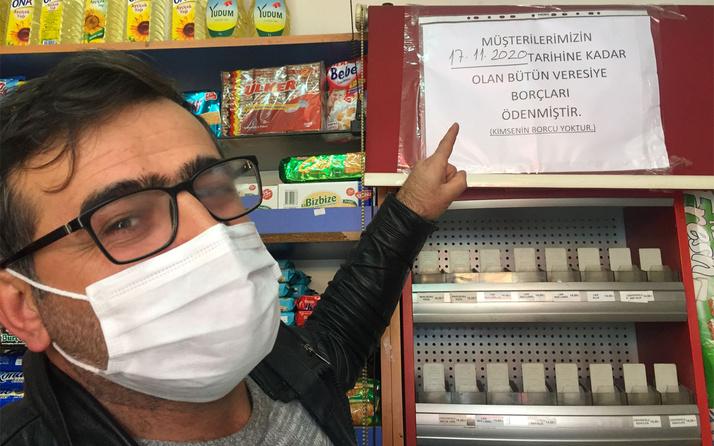 Kayseri'de iki hayırsever bakkal defterini satın aldı