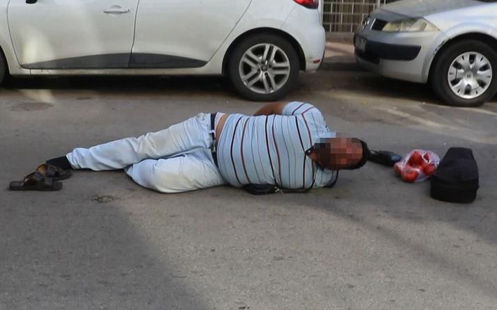 Sokakta çişini yaparken yakalandı, kelepçelenince kemanının derdine düştü