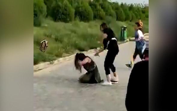 Kocasının metresini kemerle dövdü!