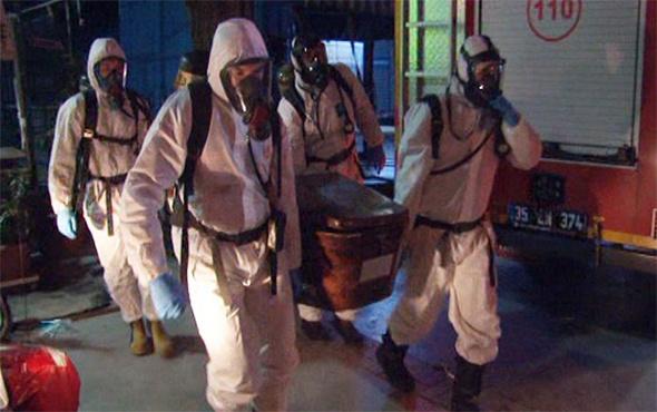 Cenaze özel korumalı kıyafet giyen ekiplerce çıkarıldı