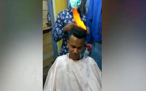 Saçı yakarak traş eden kuaför görenleri hayrete düşürüyor