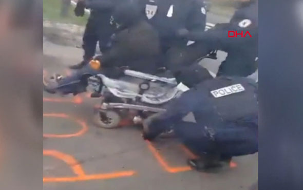 Fransız polisi, engelli eylemcinin aracının tekerini indirdi