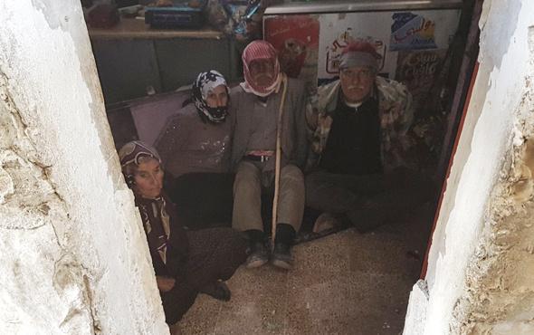 Afrin'de ele geçirilen köyde şoke eden görüntü