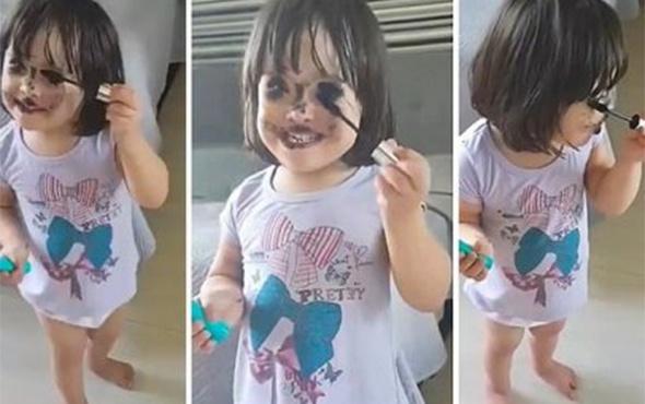 Annesinin makyaj tekniğini deneyen sevimli ufaklık