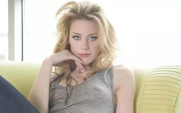 Amber Heard'dan Johnny Depp'e yumruk!