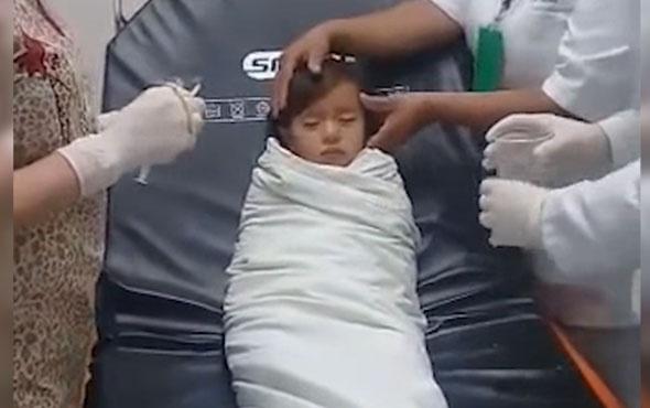 Boğazına para kaçan çocuğu böyle kurtardılar!