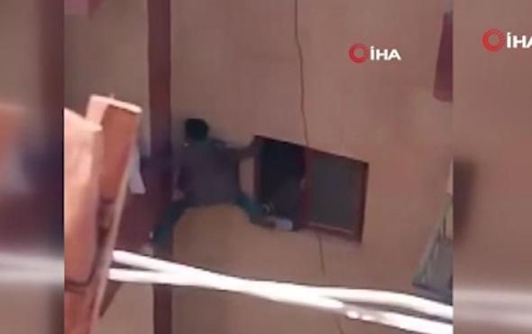 Evinin anahtarını içerde unutunca çocuğunu tehlikeye attı!