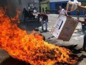 Venezuela'da çocuk göstericiyi başından vuran polis tutuklandı.