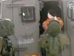 İsrail askerinden zihinsel engelli çocuğa kelepçe