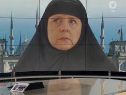 Merkel'e kara çarşaf giydirdiler