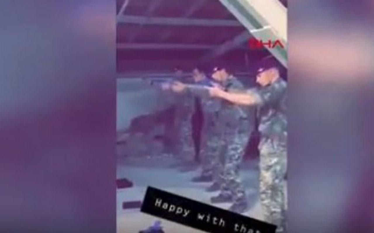 Askerler parti liderinin fotoğrafını kurşun yağmuruna tuttu