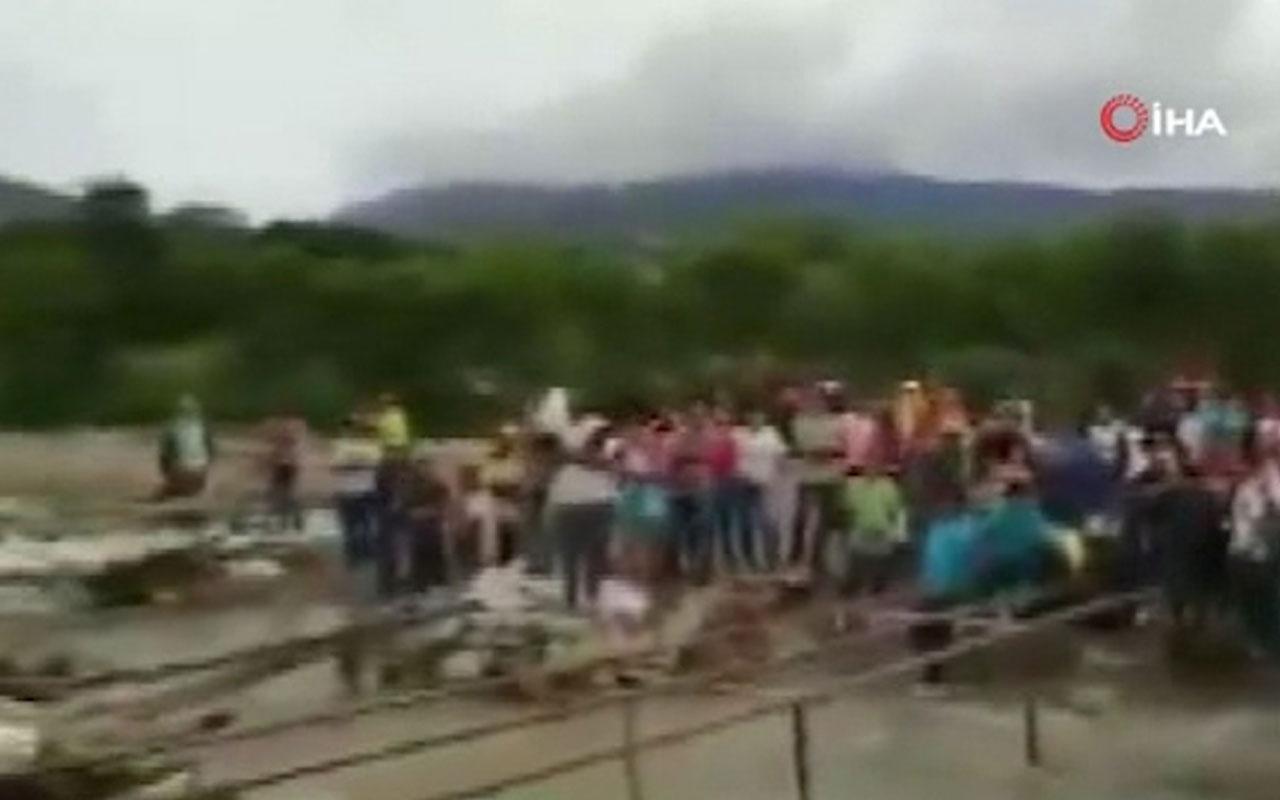 Kolombiya polisi Venezuelalıları engellemek için köprü söküyor