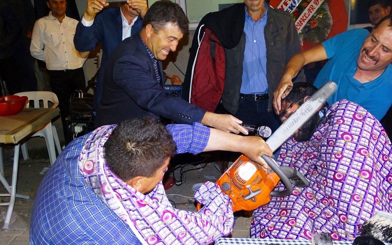 Kütahya'da köy düğününde motorlu testere ile tıraş