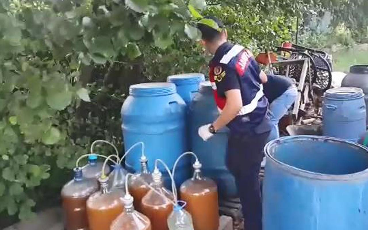 Evde ürettiği 760 litre sahte içkiyle yakalandı