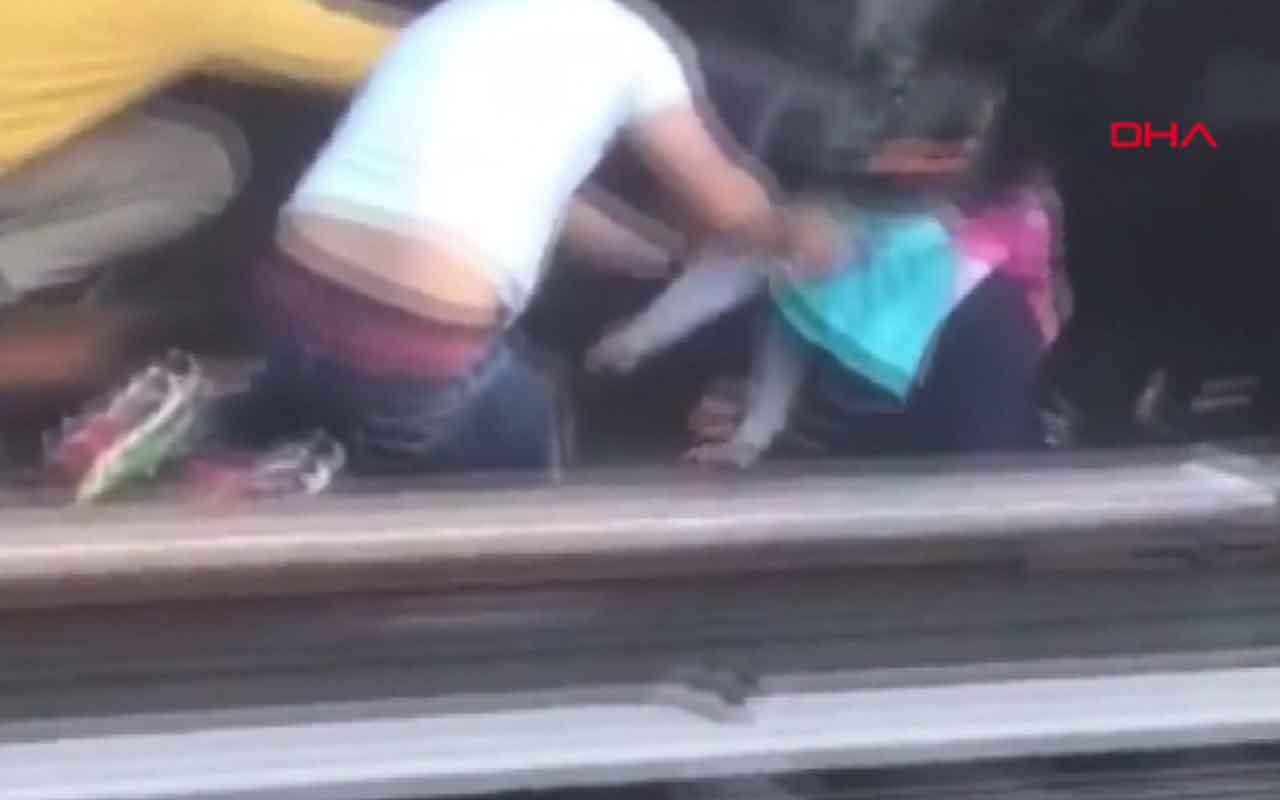 Baba küçük kızı ile tren yoluna atladı