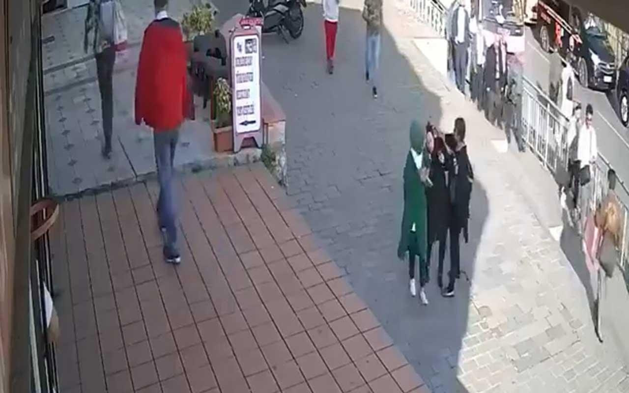 Başörtülü genç kızı darbeden kadın tutukladı